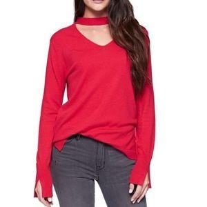 Red choker-neck sweater
